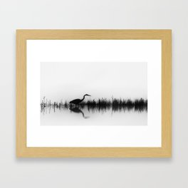 A Great Blue Heron Hunts for Food During a Foggy Morning on the Yellowstone River Framed Art Print