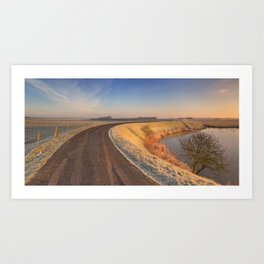 II - Typical Dutch landscape with a dike, in winter at sunrise Art Print