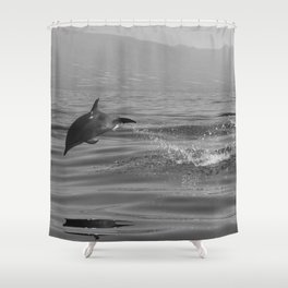 Black and white dolphin race in the ocean Shower Curtain
