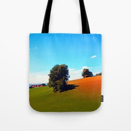 Trees, a hidden farm and fields of summer Tote Bag