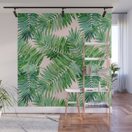 Green palm leaves on a light pink background. by art_in_life