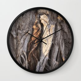 Abstract Human Figures in Gnarled Wood and White Cinder Block Wall Clock