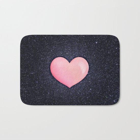 Pink heart on shiny black Bath Mat