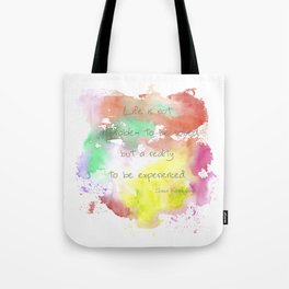 reality to be experienced. Tote Bag