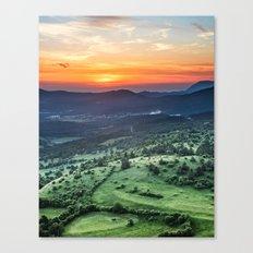 Beautiful sunset behind green fields Canvas Print