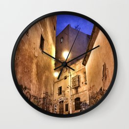 Narrow road at night with graffiti Wall Clock