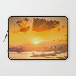 warm color tone orange sunset over hong kong urban city skyline at seafront Laptop Sleeve