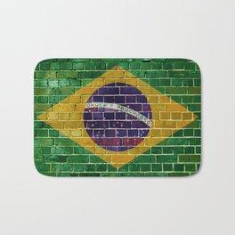 Brazil flag on a brick wall Bath Mat
