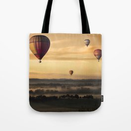Hot Air Balloons Floating Over a Foggy Landscape Tote Bag