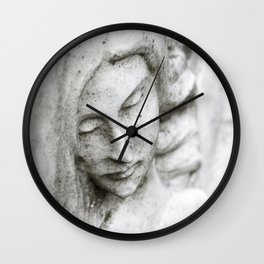 Angel face on stone memorial eyes closed Wall Clock