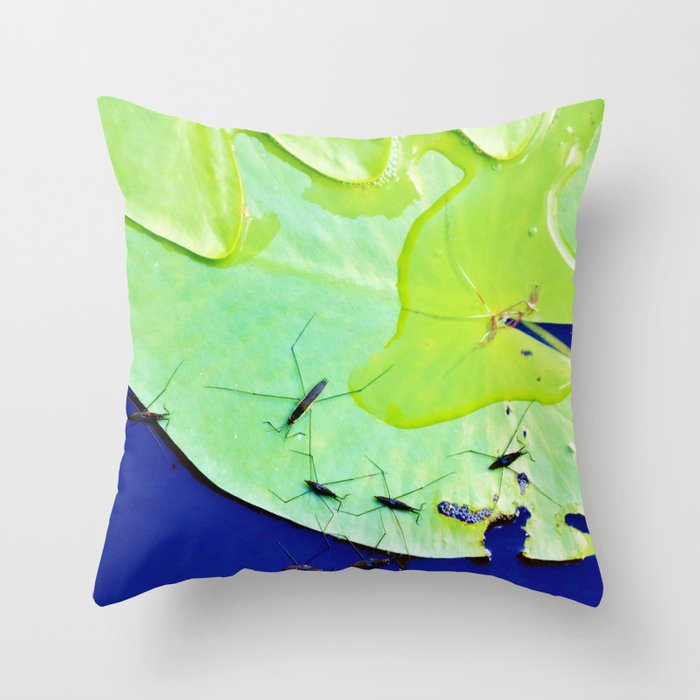 Water striders on lily pad Throw Pillow