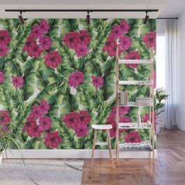 green banana palm leaves and pink flowers Wall Mural