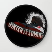 the winter soldier Wall Clocks featuring Winter Soldier Is Coming by Liam Neal