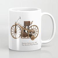 motorbike Mugs featuring Daimler Riding Car, 1885. The world's first motorbike. by Marijan Zubak