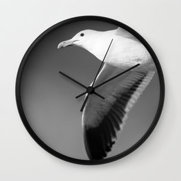 Flying seagull in black and white Wall Clock