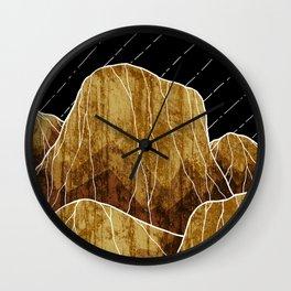 The golden rocks under the stars Wall Clock
