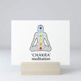 Woman in meditation with the seven chakras and its respective colors Mini Art Print