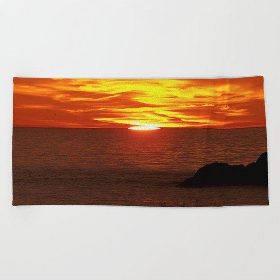 Flaming Skies Across the Sea Beach Towel