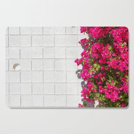 Bougainvilleas and White Brick Wall in Palm Springs, California Cutting Board