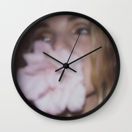 Girl with the flower in her mouth Wall Clock