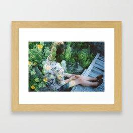 in the flowers  Framed Art Print