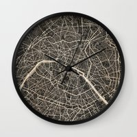 paris map Wall Clocks featuring Paris map by NJ-Illustrations