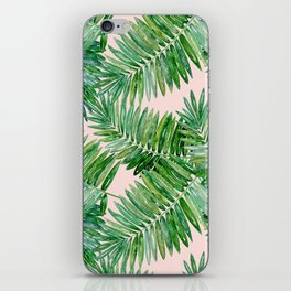 Green palm leaves on a light pink background. iPhone Skin
