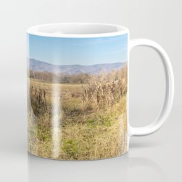 Cornfield in bright yellow colors with mountains in the background Coffee Mug