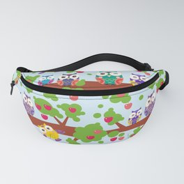 bright colorful owls on the branch of a tree with red apples on blue background Fanny Pack