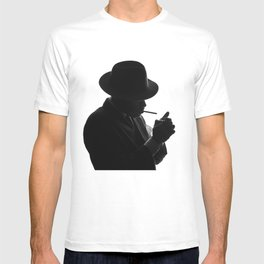 Silhouette of private detective in old fashion hat lights a cigarette T-shirt