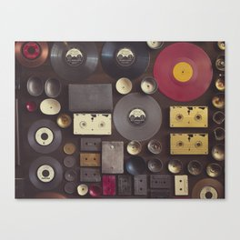 Music. Vintage wall with vinyl records and audio cassettes hung. Canvas Print