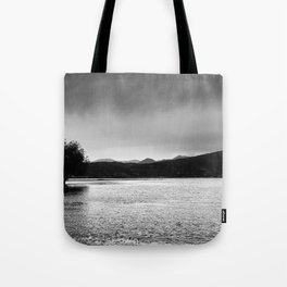 The lonely tree in the sea  Tote Bag