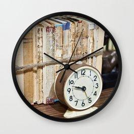 Old books on shelf and alarm clock Wall Clock