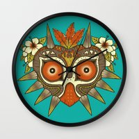 majora Wall Clocks featuring Tiki Majora by Paula García