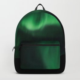 Green northern lights in the night sky Backpack