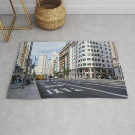Gran Via avenue in Madrid, Spain Rug
