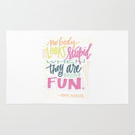 nobody looks stupid when they are having fun. Rug