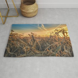 Sunset over corn field Rug