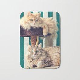 Siberian cats on the cat tree Bath Mat