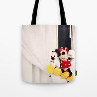 minnie mouse Tote Bags featuring Mickey and Minnie Mouse by castle on a cloud