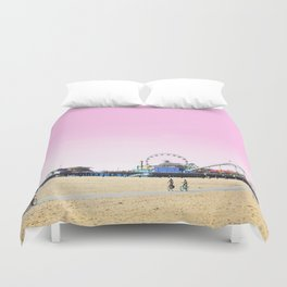 Santa Monica Pier with Ferries Wheel and Roller Coaster Against a Pink Sky Duvet Cover