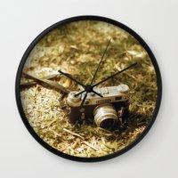 vintage camera Wall Clocks featuring camera by inesmarinho