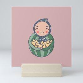 Carrying lemons Mini Art Print