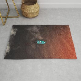 A boat on the ocean Rug