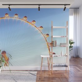 orange Ferris Wheel in the city with blue sky Wall Mural