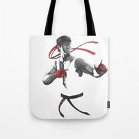 street fighter Tote Bags featuring Ryu Street Fighter by Papan Seniman