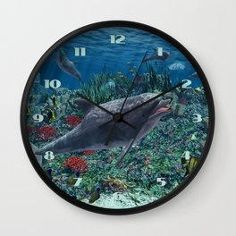Dolphins play in the reef Wall Clock