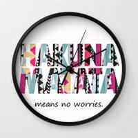 hakuna Wall Clocks featuring Hakuna Matata by Amy Copp