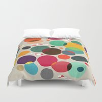 lotus Duvet Covers featuring Lotus in koi pond by Picomodi