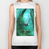 swimming Biker Tanks featuring Swimming dolphin by nicky2342